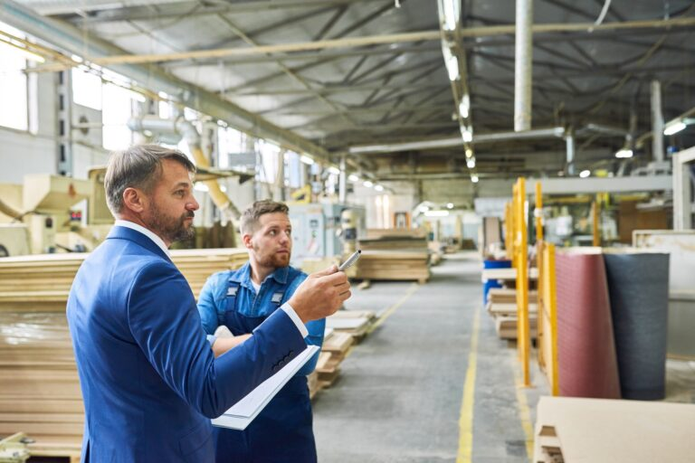 Side,View,Portrait,Of,Handsome,Mature,Businessman,Touring,Modern,Factory